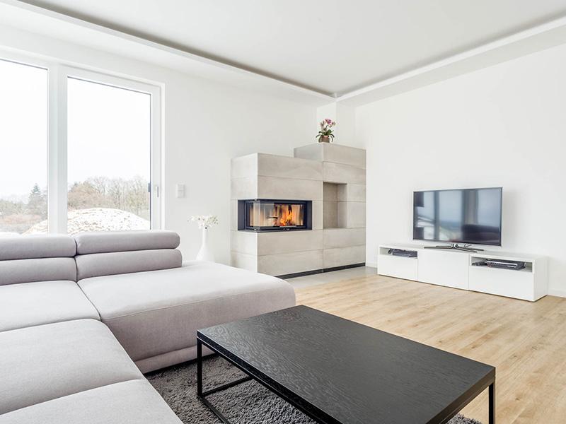 Aumer Massivhaus, Haus des Monats Juni, Wohnzimmer mit Kamin